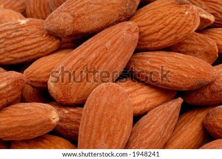 Macro photo of salted almonds - stock photo