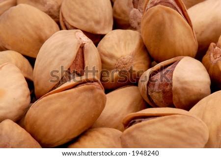 Macro photo of salted pistachios - stock photo