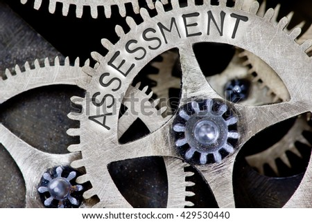 Macro photo of tooth wheel mechanism with ASSESSMENT concept words - stock photo