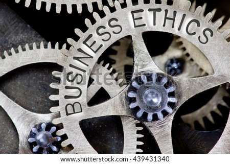 Macro photo of tooth wheel mechanism with BUSINESS ETHICS concept letters - stock photo