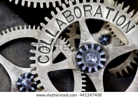 Macro photo of tooth wheel mechanism with COLLABORATION concept letters - stock photo
