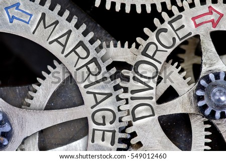 Macro photo of tooth wheel mechanism with imprinted arrows and MARRIAGE, DIVORCE concept words
