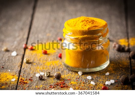 Macro photo of turmeric powder with spices. Yellow curry. - stock photo
