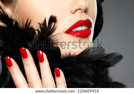 Macro photo of  woman with fashion red nails and sensual lips - stock photo