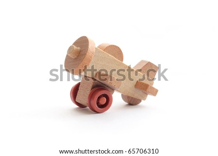 Macro photograph of a one-inch toy airplane isolated on a white background. - stock photo