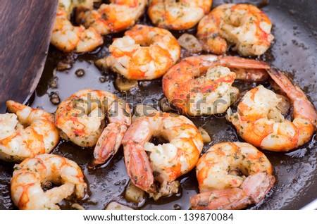 macro photograph of a shrimp and garlic stew - stock photo