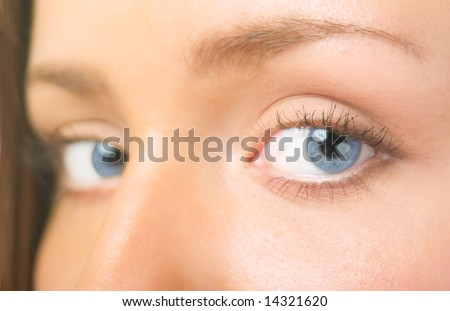 Macro photography blue eyes of young girl - stock photo
