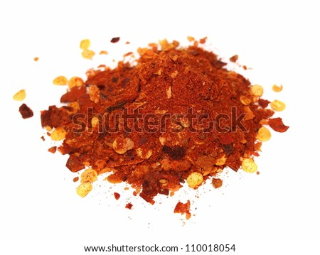 macro pile crushed red pepper isolated on white background - stock photo