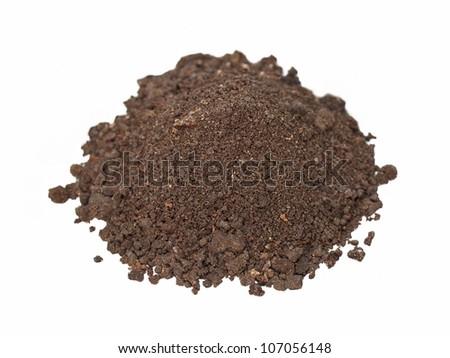 macro pile dirt isolated on white background - stock photo