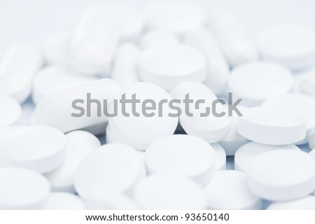 Macro pills over white background - stock photo