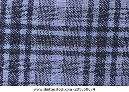 macro purple plaid fabric texture in a cage studio