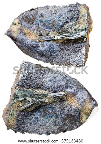macro shooting of natural mineral stone - two specimen of vivianite crystals in fossil rock isolated on white background - stock photo