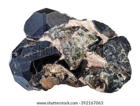 macro shooting of natural rock specimen - black, green diopside gemstones and black spinel gem isolated on white background