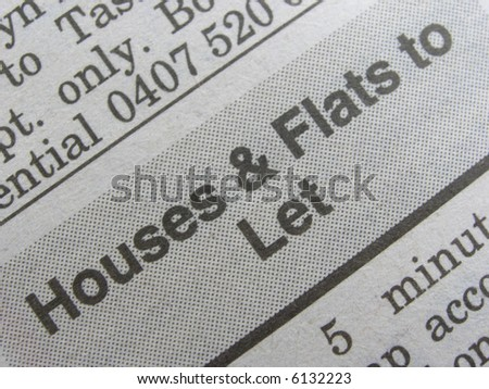 Macro shot newspaper classified section for home hunters.