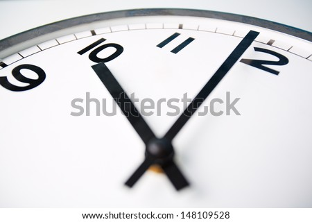 Macro shot of a clock face showing ten o�¢??clock - stock photo