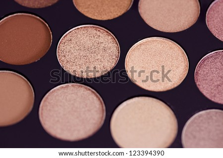 macro shot of a colorful palette of cosmetics - stock photo