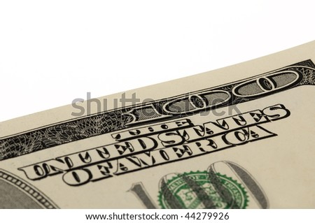 Macro shot of a corner of the US $100 bill - stock photo