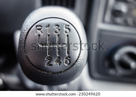 macro shot of a dirty manual gear shift - stock photo