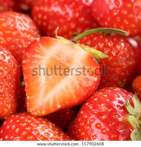 Macro shot of a fresh organic strawberry with more strawberries in the background