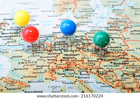 Macro shot of a map showing main western Europe cities with a colorful tack - stock photo