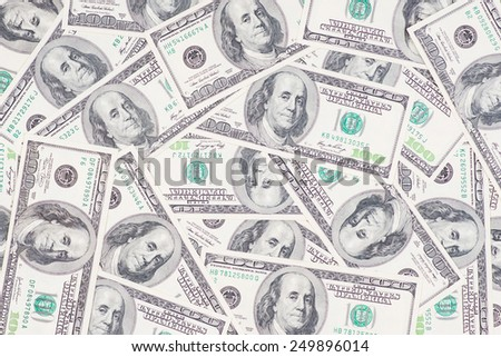 Macro shot of a messy carpet of 100 US$ money notes. - stock photo
