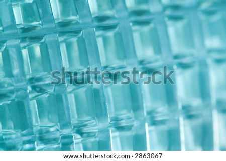 Macro shot of a plastic object colored cyan, usable as background