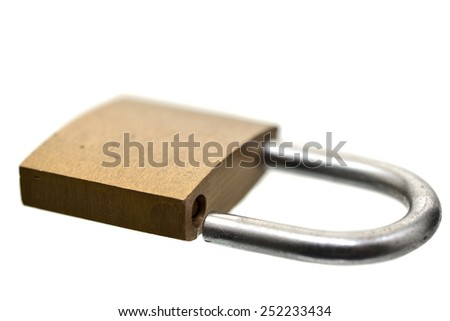Macro shot of a small pad lock on white - stock photo