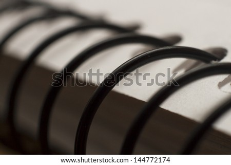 Macro shot of a spiral notebook and colored plain folders. Studio shot. - stock photo