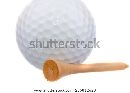 Macro shot of a wooden tee with a golf ball behind it on a white background
