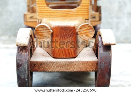 Macro shot of an old wood toy truck front  - stock photo