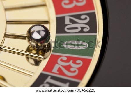 Macro shot of beautiful golden roulette on a black background.