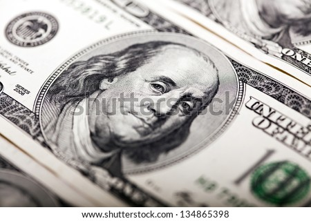Macro shot of Benjamin Franklin's portrait on a 100 US$ money note.