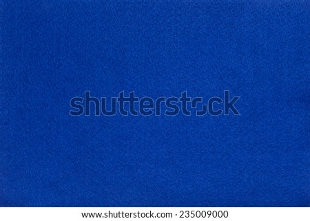 Macro shot of blue felt tissue cloth, closeup texture background with details in structure. - stock photo