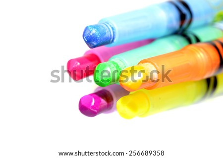 Macro shot of colorful wax crayons on a white background - stock photo