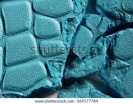 Macro shot of cracked cyan shadows - stock photo