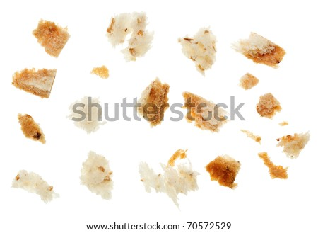 Macro shot of dried bread crumbs isolated on white - stock photo