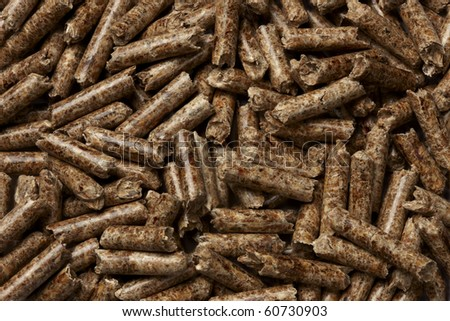 macro shot of energy efficient wood pellets fills frame - stock photo