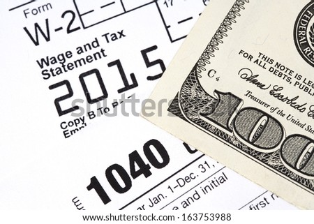 Macro shot of essential tax documents to file a US tax return.