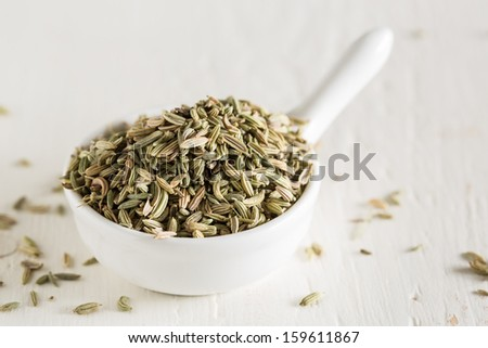 Macro shot of fennel seeds in small white bowl