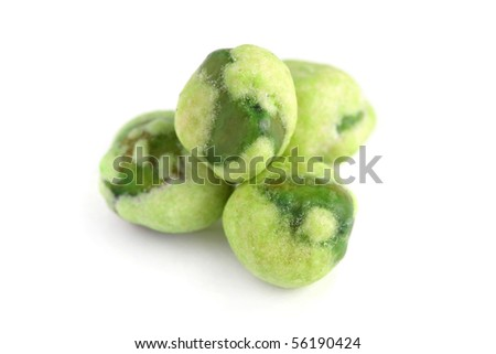 Macro shot of four wasabi coated green peas isolated on white background.