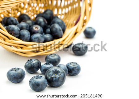 Macro shot of fresh ripe blueberries in wicker basket - stock photo