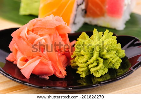 Macro shot of ginger and wasabi on the plate - stock photo