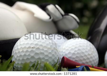 Macro shot of golf equipment on the fairway - stock photo