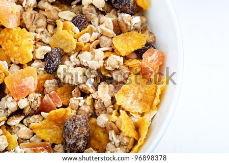 Macro shot of healthy cereal with oats, cornflakes and dried fruit - stock photo