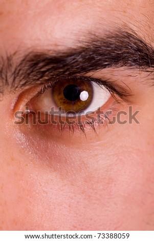 Macro shot of man's eye - stock photo