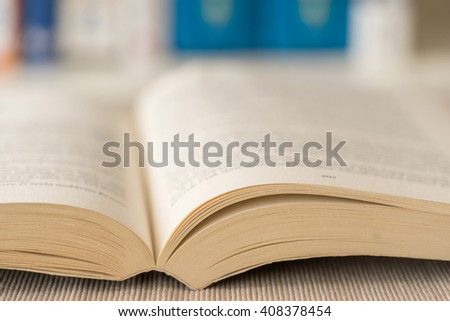 Macro shot of open book in library. Selective focus. Horizontal view. - stock photo