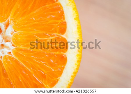 Macro shot of orange fruit on a wooden background.