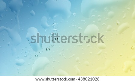 Macro shot of some raindrops on a window against soft colorful background. Water freshness background. Clear drinking water concept background. - stock photo