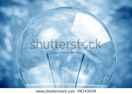 Macro shot of the filament with blurred background - blue toned image - stock photo