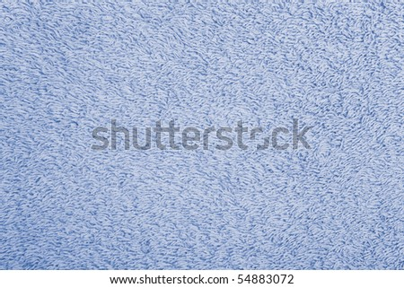 Macro shot of the surface of a cotton towel (sidelit for extra contrast). - stock photo